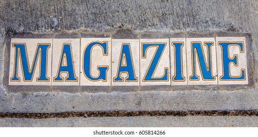 Sidewalk sign for Magazine Street in New Orleans, Louisiana