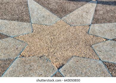 in the sidewalk star made of stone like background
