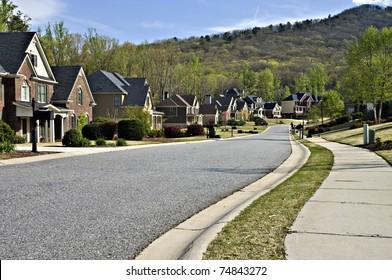 Sidewalk and street in a beautiful modern nieghborhood.