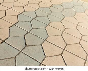 Sidewalk tile. Close-up paving slabs by mosaic. Road paving, construction. Colored concrete paving slab. Diagonal.