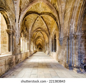 sideway of the 14th century cloister attached to the se cathedral of Lisbon, capital of Portugal, with weathered stone pillars