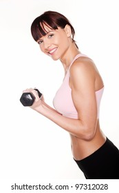 Sideways view of an athletic young woman holding a dumbbell in her hand