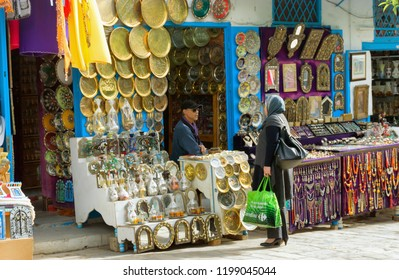 SIDI BOU SAID, TUNISIA -APRIL 3: Woman shops in the market in Sidi Bou Said, Tunisia on April 3, 2018.
