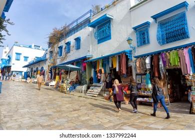 SIDI BOU SAID, TUNISIA- APRIL 3: View of the Sidi Bou Said medina with its traditional market and tourists in Tunisia on April 3, 2018