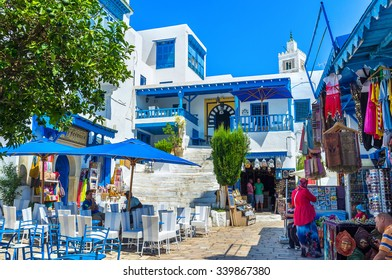 SIDI BOU SAID, TUNISIA - AUGUST 31, 2015: The luxury village consists of beautiful villas and traditional arabic cottages located on the mountain top, on August 31 in Sidi Bou Said.