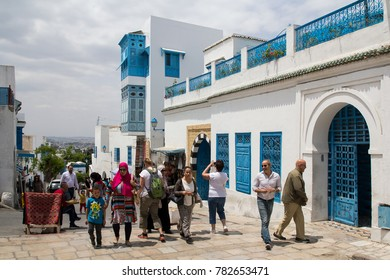 SIDI BOU SAID, TUNISIA - AUGUST 31, 2017: Many tourists visit this village from Tunis, enjoying authentic arabic architecture, local cuisine and hand made souvenirs, on August 31 in Sidi Bou Said