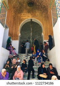 Sidi Boumediene Mosque, Tlemcen, Algeria - March 31, 2017: Visitors of the mosque are having rest at the stairs in front of the main door of the mosque.