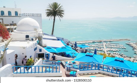 Sidi Boussaid / Tunisia - April 2018; Blue and White painted houses and buildings at Cafe Sidi Chebaane in the old town of Sidi Boussaid, Tunisia, North Africa.