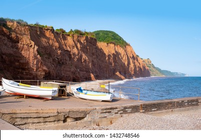 Sidmouth, Devon, UK, boats on slipway to beach on summer evening. Part of the jurassic coast and south west coast path.
