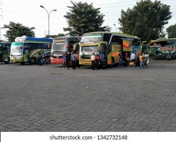 Sidoarjo, Indonesia - December 24th 2017: Bus parked in Terminal Bungurasih with the atmosphere of people return to their hometown by Bus. or it called Suasana Mudik, or Pulang Kampung dengan Bis