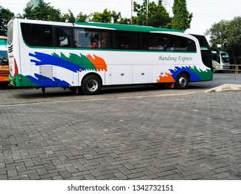 Sidoarjo, Indonesia - December 24th 2017: Bis Bandung Express in Terminal Bungurasih with situation of  Mudik, or Pulang Kampung dengan bis or The atmosphere of people return to their hometown by Bus.