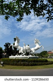 Sidoarjo, Indonesia - May 15, 2018: Statues of white horses adorn the residential complex Citra Harmoni Sidoarjo, Indonesia, produced by Ciputra Group artists