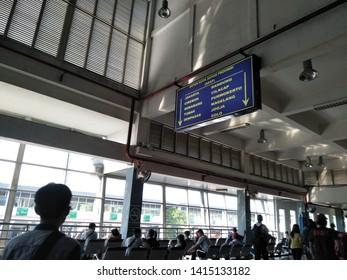 Sidoarjo, Indonesia - May 30th 2019: crowd atmosphere of people return to their hometown by Bus. or it called Suasana Mudik, or Pulang Kampung dengan Bis at Terminal Bungurasih Station on holiday walk
