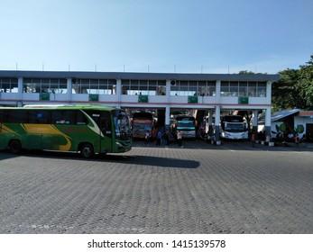 Sidoarjo, Indonesia - May 30th 2019: Bus parked in Terminal Bungurasih with the atmosphere of people return to their hometown by Bus. or it called Suasana Mudik, or Pulang Kampung dengan Bis