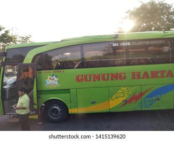 Sidoarjo, Indonesia - May 30th 2019: crowd atmosphere of people family walk return to their hometown by Bus. or it called Suasana Mudik, or Pulang Kampung dengan Bis at Terminal Bungurasih on holiday
