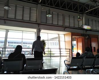 Sidoarjo, Indonesia - May 30th 2019: Inside terminal bungurasih view atmosphere of people return to their hometown by Bus or it called Suasana Mudik, or Pulang Kampung dengan Bis, wait at waiting room