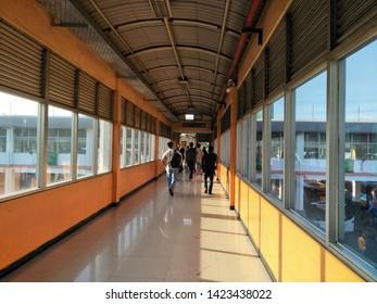 Sidoarjo, Indonesia - May 30th 2019: Inside terminal bungurasih view atmosphere of people return to their hometown by Bus or it called Suasana Mudik, or Pulang Kampung dengan Bis, hallway to parked