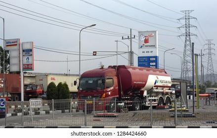 Sidoarjo, Indonesia - October 28, 2018: Refueling truck Indonesian oil company, Pertamina in Sidoarjo, East Java, Indonesia