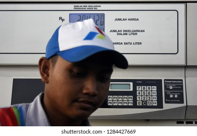 Sidoarjo, Indonesia - October 28, 2018: Gas station workers in refueling an Indonesian oil company, Pertamina in Sidoarjo, East Java, Indonesia