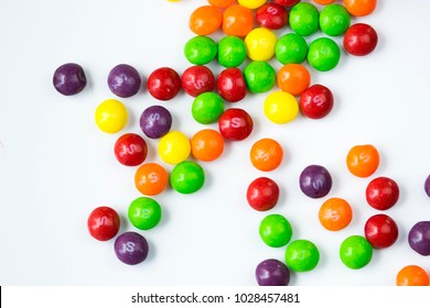 SIEDLCE, FEBRUARY 18th 2018 : Colorful skittles candies on a white background.