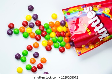 SIEDLCE, FEBRUARY 19th 2018 : Colorful skittles candies on a white background.