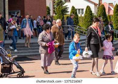 SIEDLCE, POLAND - FEBRUARY 20, 2019: People going out of church on Holy Saturday with Easter baskets after blessing, polish tradition.