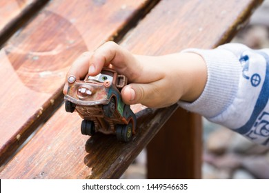 Siedlce, Poland - July 12th 2019 - A three year old boy playing with a Mattel Disney Pixar toy Tow Mater