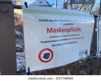Siegen,NRW,Germany - 02.15.2021 : A sign indicates the FFP2 mask requirement as a result of the corona pandemic on playgrounds.