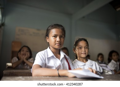 SIEM REAP - CAMBODIA / 08.12.2015: School girls in the classroom at the local Khmer village near to Siem Reap, Cambodia
