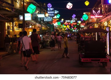 SIEM REAP, CAMBODIA - 29TH MARCH 2017: Bars, restaurants and lights along Pub Street in Siem Reap Cambodia at night. Lots of people can be seen.