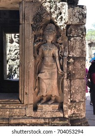 SIEM REAP, CAMBODIA 5 JUNE 2017: Art object of Khmer Costumes and Ornaments of the Devatas of Angkor Wat on the wall at Angkor - UNESCO World Heritage Centre
