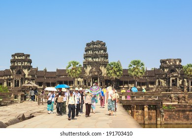 SIEM REAP, CAMBODIA - APR 07: People visiting Angkor Wat temple, Angkor archaeological park, Cambodia. There are thousands tourist visit Angkor Wat every day. On April 07, 2014.