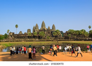 SIEM REAP, CAMBODIA - APR 07: People visiting Angkor Wat temple, Angkor archeological park, Cambodia. There are thousands tourist visit Angkor Wat every day. On April 07, 2014.