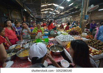 Siem Reap, Cambodia - August 21, 2016: Dessert stall and fruit stall at Psar Chaa Market (Old Market)