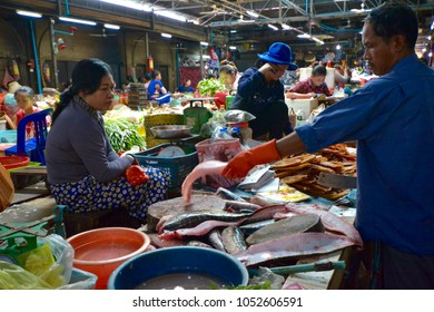 Siem Reap, Cambodia - August 21, 2016: Fishmongers at Psar Chaa Market (Old Market)
