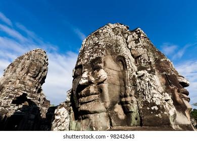SIEM REAP, CAMBODIA: Famous head statues of ancient Prasat Bayon temple at Angkor Wat.