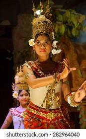 SIEM REAP, CAMBODIA - FEB 14, 2015 - Apsara dancer in red skirt performs at an evening recital,  Siem Reap,  Cambodia