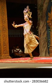 SIEM REAP, CAMBODIA - FEB 14, 2015 - Solo Apsara dancer uses hand gestures to tell a story,  Siem Reap,  Cambodia