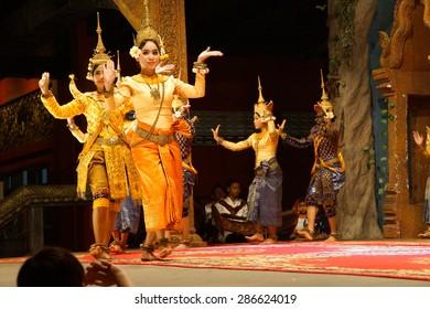 SIEM REAP, CAMBODIA - FEB 14, 2015 - Line of apsara dancers perform at a recital,  Siem Reap,  Cambodia
