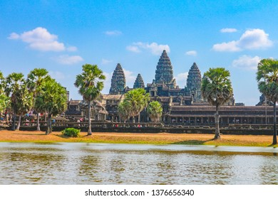 Siem Reap, Cambodia- FEB 2, 2019: Angkor Wat temple, the world largest Hindu temple reflect on water in sunny day.