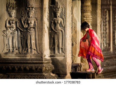 SIEM REAP, CAMBODIA - FEB 8:Asian visitor at Angkor Wat on Feb 8, 2014. Angkor Wat was build in early of 12th century, and becomes a symbol of Cambodia which also appears on the national flag.