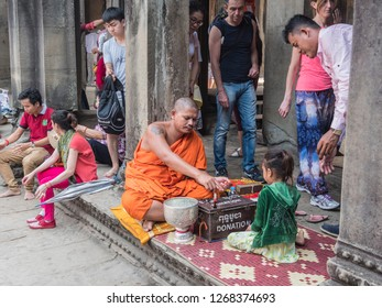 Siem Reap, Cambodia - February 18, 2018: A hindu priest has put up his altar in the ruins of Angkor Wat. At Siem Reap, cambodia
