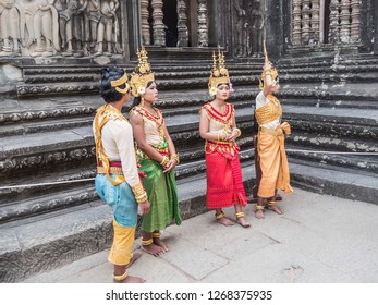 Siem Reap, Cambodia - February 18, 2018: actors pose in historic costumes between the ancient ruins of Angkor Wat, at Siem Reap, Cambodia