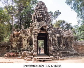 Siem Reap, Cambodia - February 19, 2018: view of one of the temples of Angkor Wat, at Siem Reap, Cambodia. A tree is growing on the temple.