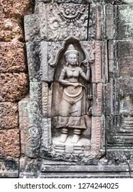 Siem Reap, Cambodia - February 19, 2018:A statue of a Khmer woman in the ruins of Angkor Wat, at Siem Reap, Cambodia