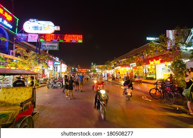 SIEM REAP, CAMBODIA - JAN  4, 2014: Unidentified tourists shop at the night market of Siem Reap on Jan 4,2014. It serves as a gateway to the world famous Angkor temples and is a major tourist hub.