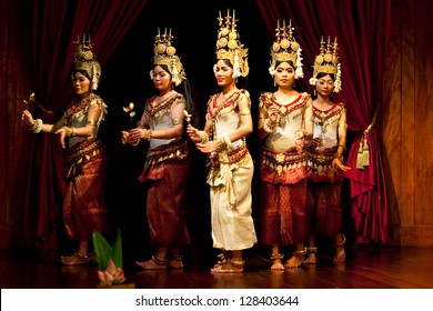 SIEM REAP, CAMBODIA - JANUARY 04: Khmer classical dancers performing in traditional costume on January 04, 2013 in Siem Reap, Cambodia. Apsara Dance is the ancient classical dance form of Cambodia
