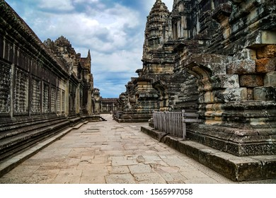 Siem Reap, CAMBODIA - July 17, 2019: Angkor Wat, empty temple inside, no people, cloudy sky, embossed walls, horizontal photo