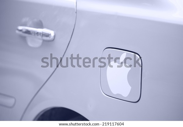 SIEM REAP, CAMBODIA - JUNE 28, 2014: The logotype Apple on a car fuel cell flap. Cambodia is a poor country and Apple is the most popular brand subject to falsification.