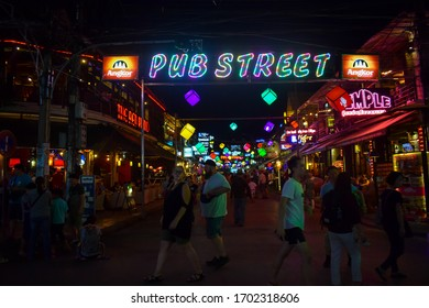SIEM REAP, CAMBODIA - MARCH 15 2018: People walking on the Siem Reap Pub Street during night